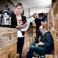Nederland, Amsterdam , 17 november 2011..De 3 mensen van Winefield's auctioneers aan het werk in de wijnopslagruimte..v.l.n.r. Doris Vroom, Milan Veld en Patricia Verschelling.Foto:Jean-Pierre Jans