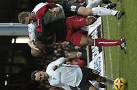 Photo: Ian Hebden.<br />Luton Town v Stoke City. Coca Cola Championship.<br />17/12/2005.<br />Stoke's Michael Duberry (C) fends of Luton's Steve Howard (R).