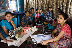 Women in tailoring workshop listen to and educational presentation on TB by members of Lok Seva Sangam, a local NGO that works on TB issues.  Lok Seva Sangam travels all over the slums giving educational talks to different at risk groups.
