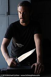 Custom bike builder and knife maker Lock Baker in his shop. Los Angeles, CA, USA. Thursday, June 21, 2018. Photography ©2018 Michael Lichter.