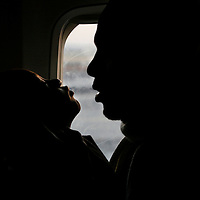 An Ethiopian Falash Mura man kisses his baby as the light from Ethiopian arrives to Israel, May 2008.
