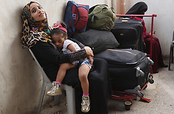 August 16, 2017 - Gaza City, Gaza Strip, Palestinian Territory - Palestinians wait for travel permits to cross into Egypt through the Rafah border crossing after it was opened by Egyptian authorities for humanitarian cases, in Rafah in the southern Gaza Strip. (Credit Image: © Ashraf Amra/APA Images via ZUMA Wire)