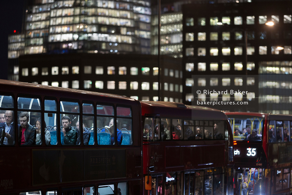Buses and heavy traffic cross London Bridge, from Southwark to the City of London, on 2nd November 2018, in London, England.
