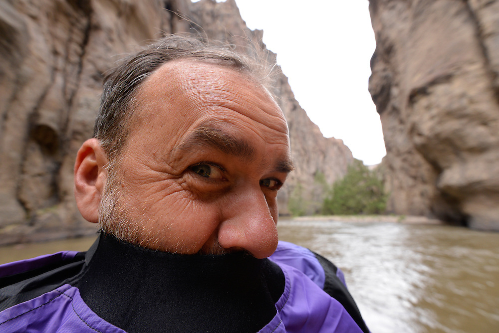 Kayaker with paddle jacket raised up over his mouth, Bruneau River, Idaho.