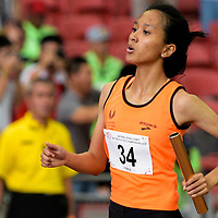 Ismi Zakiah (#34) of Singapore Sports School finishes first in the A Division girls' 4x100m relay final with a timing of 12.35s. (Photo © Eileen Chew/Red Sports)