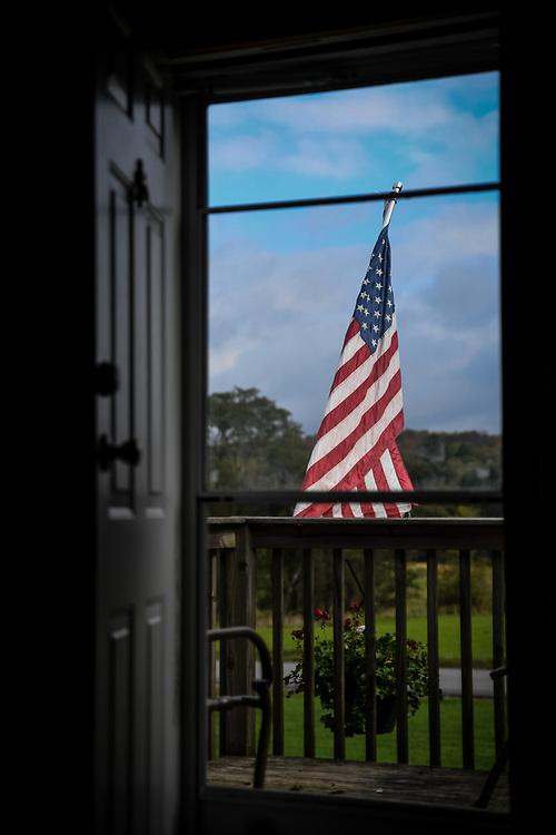 The American flag flies outside Duke's home.