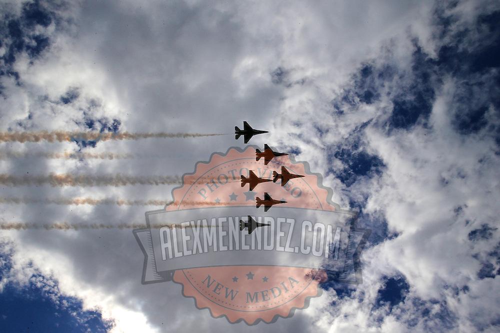 Members of the U.S. Airforce Thunderbirds perform a flyover during the 58th Annual NASCAR Daytona 500 auto race at Daytona International Speedway on Sunday, February 21, 2016 in Daytona Beach, Florida.  (Alex Menendez via AP)