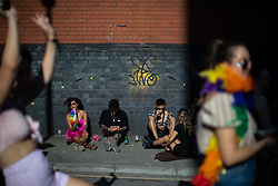 © Licensed to London News Pictures . 25/08/2019. Manchester, UK. As temperatures reach in excess of 30 degrees centigrade , fans of Ariana Grande and other musical acts gather at Mayfield Depot ahead of performances this evening . Manchester's annual Gay Pride festival , which is the largest of its type in Europe , celebrates LGBTQ+ life . Photo credit: Joel Goodman/LNP