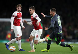 Arsenal's Aaron Ramsey (centre) and Sporting Lisbon's Nemanja Gudelj battle for the ball during the UEFA Europa League, Group E match at the Emirates Stadium, London.