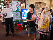 06 JULY 2011 - BANGKOK, THAILAND: An American evangelical street preacher preaches to the crowd of Muslims and Buddhists in the Soi Arab neighborhood of Bangkok. Soi Arab is an alleyway in Bangkok. What started as an alley has now grown into a neighborhood that encompasses several blocks of restaurants, hotels and money exchanges that cater to Middle Eastern visitors to Thailand. The official name of the street is Sukhumvit Soi 3/1, located in North Nana between Sukhumvit Soi 3 and Sukhumvit Soi 5, not far from the Nana Plaza night-life area and the Grace Hotel popular among Arabs.   PHOTO BY JACK KURTZ