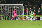 Forest Green Rovers goalkeeper Sam Russell(23) saves a shot from Tranmere Rovers James Norwood(10) during the Vanarama National League match between Forest Green Rovers and Tranmere Rovers at the New Lawn, Forest Green, United Kingdom on 22 November 2016. Photo by Shane Healey.
