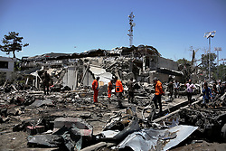 May 31, 2017 - Kabul, Afghanistan -  Rescue workers comb through the site of a car bomb explosion in Kabul, Afghanistan. At least 64 people were killed and 320 others injured in Wednesday morning's suicide car bomb explosion in a diplomatic district in Afghan capital of Kabul, the Interior Ministry said in a statement.   (Credit Image: © Rahmat Alizadah/Xinhua via ZUMA Wire)
