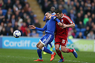 Lukas Jutkiewicz of Birmingham city ® Challenges Jazz Richards of Cardiff city (l) .  EFL Skybet championship match, Cardiff city v Birmingham City at the Cardiff City Stadium in Cardiff, South Wales on Saturday 11th March 2017.<br /> pic by Andrew Orchard, Andrew Orchard sports photography.
