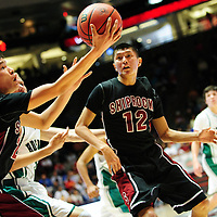 031413  Adron Gardner/Independent<br /> <br /> Shiprock Chieftain Justin Begay (20) reaches for a rebound ahead of teammate Hiram Gleason (12) during the 3A New Mexico High School Basketball tournament semifinals at The Pit in Albuquerque Friday.