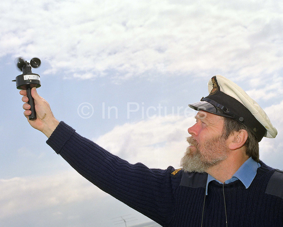An assistant lighthouse keeper records the wind speed at St Catherine's Lighthouse, Isle of Wight, UK.  Before automation, the lighthouse had been a weather reporting station for the Meteorological Office for some years; the keepers made hourly reports which included the temperature, humidity, cloud height and formation and wind direction and force. Following de-manning of the lighthouse an automatic weather reporting station was installed which sends details of the weather conditions to the Met. Office. St Catherine's Lighthouse was automated in 1997 and all Trinity House lighthouses have been automated since November 1998.