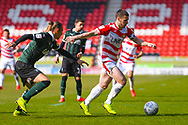 Tommy Rowe of Doncaster Rovers (10) and Oscar Threlkeld of Plymouth Argyle (26) in action during the EFL Sky Bet League 1 match between Doncaster Rovers and Plymouth Argyle at the Keepmoat Stadium, Doncaster, England on 13 April 2019.