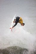 Chris Waring competing in the Katin Pro/Am surf competition at Huntington Beach Pier, Orange County, California.