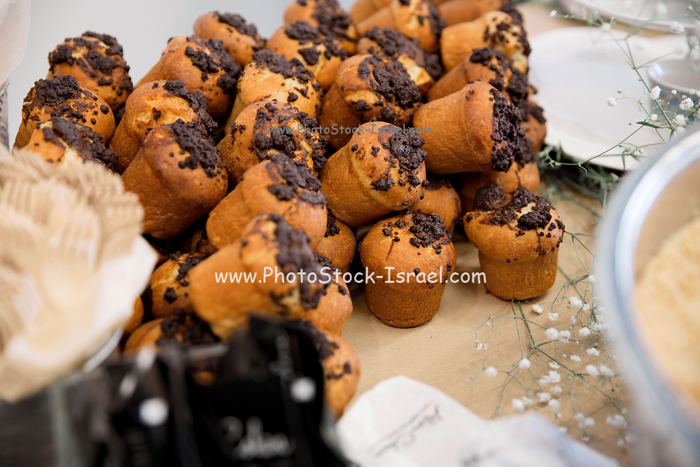 cupcakes and muffins on display on a breakfast buffet table