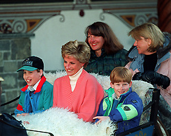 PA NEWS PHOTO : 27/3/94 : THE PRINCESS OF WALES AND HER SONS, PRINCES WILLIAM (LEFT) AND HARRY RIDE IN A HORSE DRAWN SLEIGH AS THEY LEAVE THEIR HOTEL IN LECH, AUSTRIA. THEY ARE ACCOMPANIED BY THE PRINCESS'S FRIENDS CATHERINE SOAMES AND KATE MENZIES. PHOTO BY MARTIN KEENE.