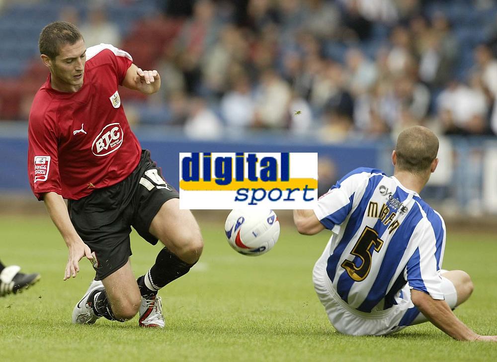 Photo: Aidan Ellis.<br /> Huddersfield Town v Bristol City. Coca Cola League 1. 12/08/2006.<br /> Bristol's Phil jevons and Huddersfield's David Mirfin tackle for the ball