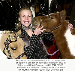 Restaurant owner MISS SOPHIA BURRELL and ponies, at a party in London on 13th November 2001.OUE 21