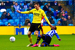 Moses Odubajo of Sheffield Wednesday slides in to tackle Jed Wallace of Millwall - Mandatory by-line: Ryan Crockett/JMP - 01/02/2020 - FOOTBALL - Hillsborough - Sheffield, England - Sheffield Wednesday v Millwall - Sky Bet Championship