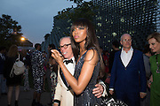TOMMY HILFIGER; NAOMI CAMPBELL, 2016 SERPENTINE SUMMER FUNDRAISER PARTY CO-HOSTED BY TOMMY HILFIGER. Serpentine Pavilion, Designed by Bjarke Ingels (BIG), Kensington Gardens. London. 6 July 2016