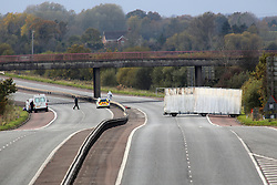 Forensic officers  at the scene of the  murder of prison officer David Black on the M1 motorway in County Armagh, Northern Ireland, Thursday, Nov 1st 2012.  Photo by: Paul McErlane / i-Images