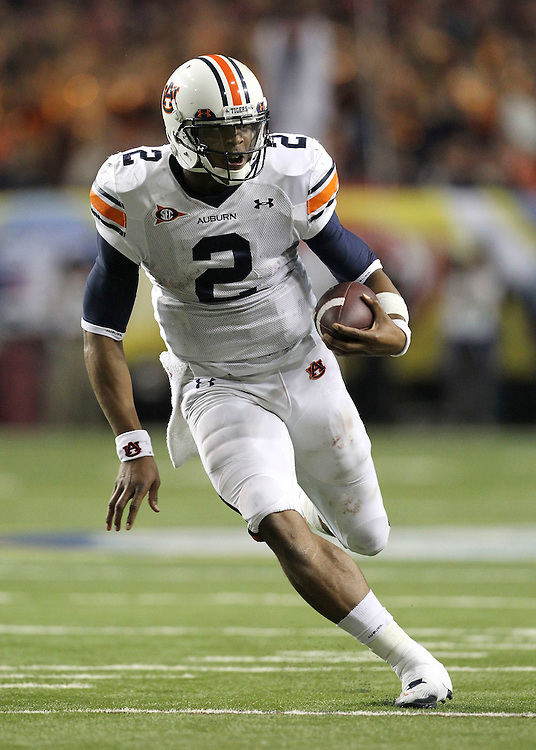 ATLANTA - DECEMBER 4:  Quarterback Cam Newton #2 of the Auburn Tigers runs with the ball during the 2010 SEC Championship against the South Carolina Gamecocks at Georgia Dome on December 4, 2010 in Atlanta, Georgia. (Photo by Mike Zarrilli/Getty Images)