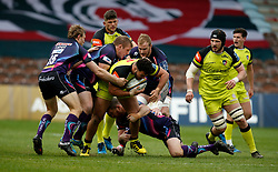 Leicester Tigers' Ellis Genge and Exeter Chiefs' Lachie Turner and Carl Rimmer during the Anglo-Welsh Cup Final at Twickenham Stoop, London.