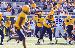 Oct 31, 2020; Morgantown, West Virginia, USA; West Virginia Mountaineers quarterback Jarret Doege (2) throws a pass during the fourth quarter against the Kansas State Wildcats at Mountaineer Field at Milan Puskar Stadium. Mandatory Credit: Ben Queen-USA TODAY Sports