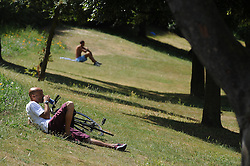 © Licensed to London News Pictures. 15/07/2013<br /> A man drinking in the sun in Riverside Park next to the Promenade.<br /> People enjoying the hot heatwave weather today (15.07.2013) on Gordon Promenade in Gravesend, Kent while police and the RNLI search the River Thames for a man that went missing in the water yesterday afternoon.<br />  Photo credit :Grant Falvey/LNP
