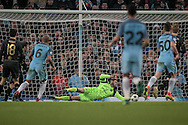 Craig Gordon (Celtic) makes a save to keep the scores level during the Champions League match between Manchester City and Celtic at the Etihad Stadium, Manchester, England on 6 December 2016. Photo by Mark P Doherty.