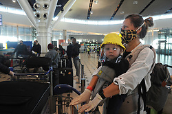 South Arica - Cape Town - 4 Jun 2020 - Coronavirus - British Nationals queue at baggage collection all wearing their protective masks. The last repatriation flight of British citizens wishing to go back home took place this morning at Cape Town International Airport. Over the last 3 months, over 5000 people have been repatriated. Over 300 000 British Nationals who work and stay in South Africa have decided to remain here. South Africa continues with its lockdown which is at level 3 now. Picture Courtney Africa/African News Agency(ANA)
