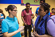 """18 AUGUST 2012 - PHOENIX, AZ:  REGINA JEFFERIES, an immigration lawyer and chairman of the Immigration Section of the Arizona Lawyers Association, talks to young people about the """"deferred action"""" program during a deferred action workshop in Phoenix. More than 1000 people attended a series of 90 minute workshops in Phoenix Saturday on the """"deferred action"""" announced by President Obama in June. Under the plan, young people brought to the US without papers, would under certain circumstances, not be subject to deportation. The plan mirrors some aspects the DREAM Act (acronym for Development, Relief, and Education for Alien Minors), that immigration advocates have sought for years. The workshops were sponsored by No DREAM Deferred Coalition.  PHOTO BY JACK KURTZ"""