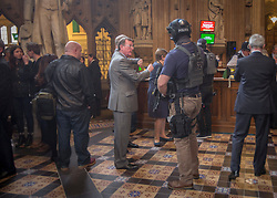 © Licensed to London News Pictures.22/03/2017. London, UK. Former Northern Ireland First Minister David Trimble stands near an armed policeman in the Central Lobby of Parliament during a lockdown in after a terrorist attack in Westminster.Photo credit: Alison Baskerville/LNP<br />