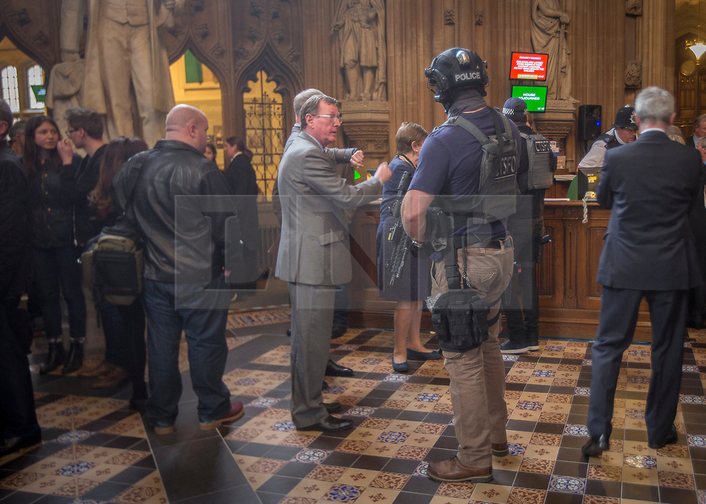 © Licensed to London News Pictures.22/03/2017. London, UK. Former Northern Ireland First Minister David Trimble stands near an armed policeman in the Central Lobby of Parliament during a lockdown in after a terrorist attack in Westminster.Photo credit: Alison Baskerville/LNP<br /> <br /> <br /> MP's and members of the public are held in Central Lobby in the Houses of Parliament as the building is locked down following a suspected terror attack.