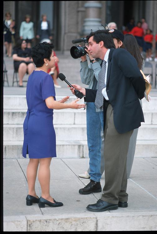 Austin, Texas: TV news crew interviews woman at Capitol protest. ©Bob Daemmrich / The Image Works