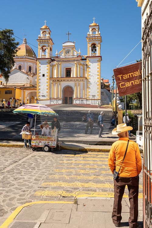 An elderly cowboy stands by the Parroquia Santa María Magdalena church in Xico, Veracruz, Mexico.