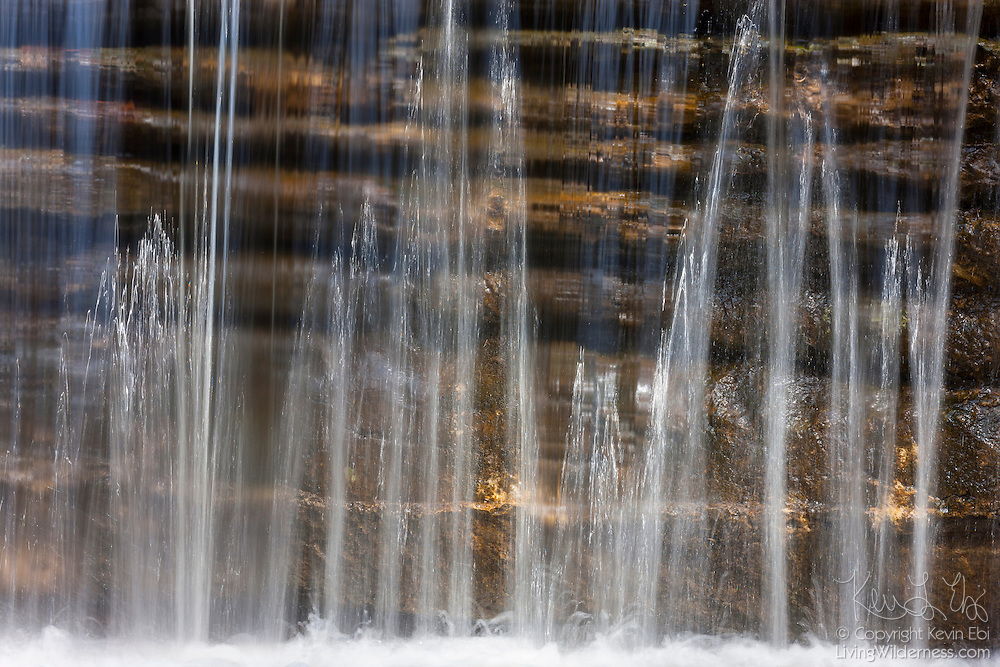 A small waterfall flows over sandstone layers in Matthiessen State Park, located in LaSalle County, Illinois. Creeks carved a canyon that's as much as 45 feet (14 meters) deep, exposing sandstone layers.