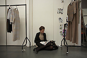 Relaxing model before British couture designer Margaret Howell's Autumn fashion show in her design studio and shop
