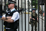 Troops deployed as part of a higher state of emergency in May 24,  London, United Kingdom.  Two soldiers on duty in Downing Street.