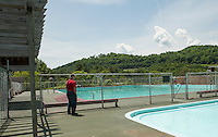 Armando Bona looks out over the pool where he worked as a young man in the 1950's prior to the 70th Anniversary celebration of the Kiwanis Pool in St. Johnsbury Vermont.  Karen Bobotas / for Kiwanis International