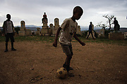 Boys play soccer at a cemetery in Harare, Ethiopia. Almost 90% of the total number of children living with HIV lives in sub-Saharan Africa and fewer than one in ten of those children are being reached by basic support services.