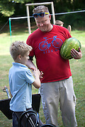 Polish son congratulating his father on picking out such a nice watermelon. Zawady Central Poland