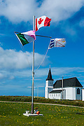 Flagpole before a church in Flower Cove, New Foundland, Canada