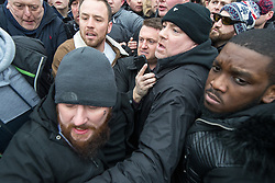 """© Licensed to London News Pictures . 18/03/2018 . London , UK . TOMMY ROBINSON (top centre) pushes his way from the crowd to leave after delivering his speech . 1000s including supports of alt-right groups such as Generation Identity and the Football Lads Alliance , at Speakers' Corner in Hyde Park where Tommy Robinson reads a speech by Generation Identity campaigner Martin Sellner . Along with Brittany Pettibone , Sellner was due to deliver the speech last week but the pair were arrested and detained by police when they arrived in the UK , forcing them to cancel an appearance at a UKIP """" Young Independence """" youth event , which in turn was reportedly cancelled amid security concerns . Photo credit: Joel Goodman/LNP"""