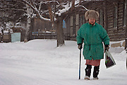 Malishevo, Russia, 29/02/2004.&#xD;An old woman struggles uphill to the village centre during a snow blizzard.<br />