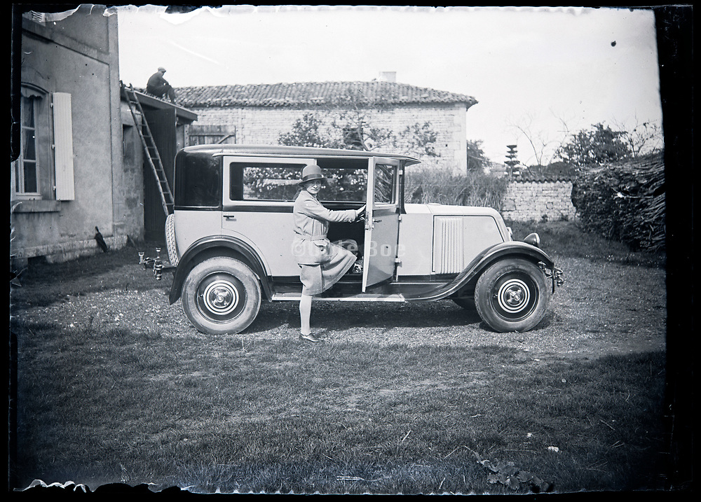 woman getting in a automobile France circa 1920s 1930s