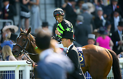 Jockey John Velazquez gives the thumbs up after winning the King's Stand Stake with Lady Aurelia during day one of Royal Ascot at Ascot Racecourse.
